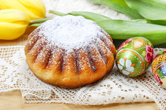 Easter cake and yellow tulips on the table Stock Image