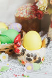 Easter cakes, coffee cup and colored eggs Stock Image