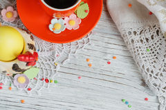 Easter cakes, coffee cup and colored eggs Stock Photo