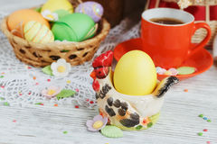 Easter cakes, coffee cup and colored eggs Stock Photography