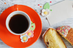Easter cakes, coffee cup and colored eggs Royalty Free Stock Images