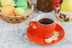 Easter cakes, coffee cup and colored eggs Royalty Free Stock Photography