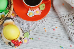 Easter cakes, coffee cup and colored eggs Royalty Free Stock Photo