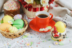 Easter cakes, coffee cup and colored eggs Royalty Free Stock Image