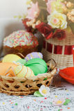 Easter cakes, coffee cup and colored eggs Stock Images