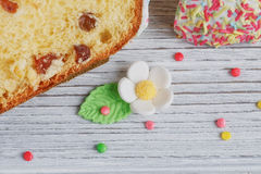 Easter cakes, coffee cup and colored eggs Stock Photos