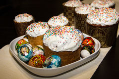 Easter cakes and colored eggs Stock Photos