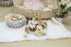 Easter cakes, colored eggs and live chickens Royalty Free Stock Image