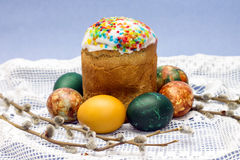 Easter cakes and colored eggs with sprig of willow Royalty Free Stock Photo