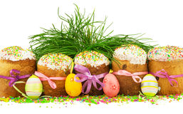 Easter cakes with colorful ribbons, decorative eggs, grass and m Stock Images