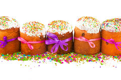 Easter cakes with colorful ribbons and multicolor sugar Stock Images