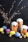 Easter cakes and eggs. On a dark, rustic, wooden background stock photos