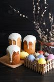 Easter cakes and eggs. On a dark, rustic, wooden background royalty free stock photography