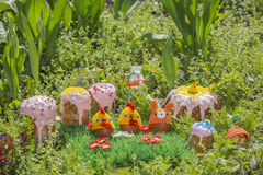 Easter cakes and eggs in funny knitted hats in the garden Stock Image