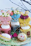 Easter cakes and gingerbread rabbits on white background. View Royalty Free Stock Photo