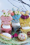 Easter cakes and gingerbread rabbits on white background. View Stock Image