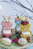 Easter cakes and gingerbread rabbits on white background. View Royalty Free Stock Photography