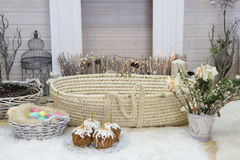 Easter cakes and painted eggs in wicker basket Stock Image