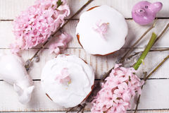 Easter cakes, pink hyacinths, willow branches, decorative rabbit Stock Image