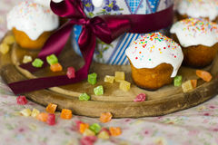 The Easter cakes with ribbon, with topping and candied fruits Stock Photo