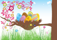 Easter. Cakes warm spring day the green grass with flowers on a background of blue sky and a tree with a nest on it containing  eggs Stock Photography
