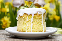 Easter cakes, yellow daffodils in the background Royalty Free Stock Image