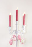 Easter candle chandelier. On a white candles holder hang colorful easter eggs Stock Photography