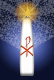 Easter candle with Christ monogram Royalty Free Stock Images