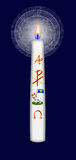 Easter candle with Christ monogram and alpha and omega symbol. And the lamb of God Stock Images