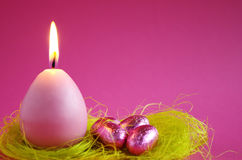 Easter candle with easter eggs Stock Photo