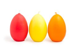 Easter candle in egg Royalty Free Stock Images