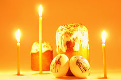 Easter candle, eggs and cake Royalty Free Stock Photos