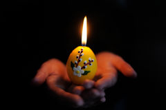 Easter candle in the hands Royalty Free Stock Photography
