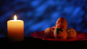 Easter candle with ornaments in the dark stock video footage