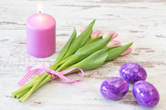 Easter candle with tulips and eggs Stock Images