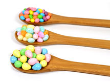 Easter candy. Colorful easter candy on three wooden spoons Royalty Free Stock Photos