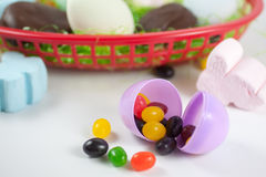 Easter Candy. Assorted Easter candies and basket on isolated on white Stock Photography