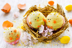 Easter candy chick in nest, festive sweet treat for children Royalty Free Stock Image