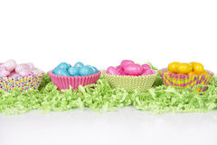Easter Candy in colorful cupcake wrappers Stock Photo