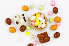 Easter candy in the nest stock photo