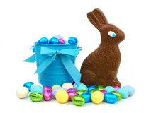 Easter candy with pail and bunny Royalty Free Stock Photography