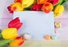 Easter Candy and Tulips Royalty Free Stock Image
