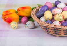 Easter Candy and Tulips Royalty Free Stock Photos
