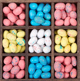 Easter candy in a wooden box. Easter candy in the shape of an egg in a wooden printers box Stock Image