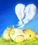 Easter card. Easter eggs, green grass and blue sky Royalty Free Stock Photography