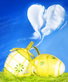 Easter card. Easter eggs, green grass and blue sky Stock Image