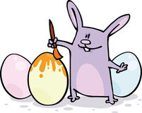 Easter card. Funny Rabbit paint Easter eggs Royalty Free Stock Photography