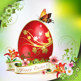 Easter card. With butterflies and decorated egg on grass Stock Photos