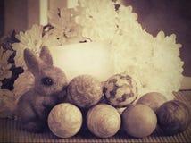 Easter eggs, bunnies, flowers. Stock Photos