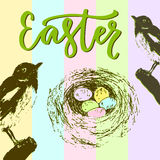 Easter card with bird nest and colorful eggs. Modern vector greeting card with lettering. and sketches hand drawn elements Stock Image